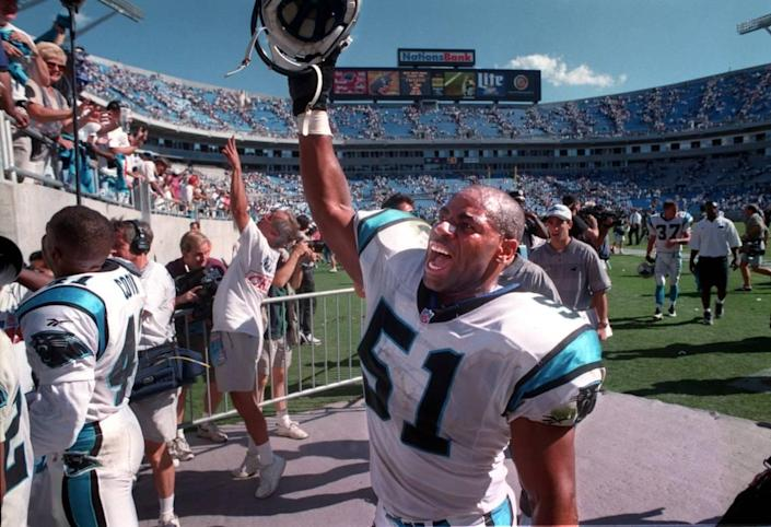 Carolina Panther linebacker Sam Mills yells to the crowd while leaving the field following an upset win over San Francisco in 1996.