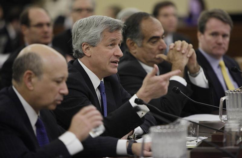 "FILE - In this Wednesday, Jan. 13, 2010 file photo, from left, Goldman Sachs Group, Inc. Chairman and Chief Executive Officer Lloyd Blankfein; JPMorgan Chase & Company Chairman and Chief Executive Officer Jamie Dimon; Morgan Stanley Chairman John Mack and Bank of America Corporation Chief Executive Officer and President Brian Moynihan, testify on Capitol Hill in Washington before the Financial Crisis Inquiry Commission. Dimon had to face stock analysts and reporters on Thursday, May 10, 2012, and confess to a ""flawed, complex, poorly reviewed, poorly executed and poorly monitored"" trading strategy that lost a surprise $2 billion. (AP Photo/Pablo Martinez Monsivais, File)"