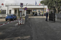 A view of the entrance of the San Giuliano hospital in Giugliano, in the outskirts of Naples, Italy, Saturday, Nov. 14, 2020. The pandemic has heightened the urgency of the plight of those seeking medical care in public hospitals in Italy's economically under-developed south. (AP Photo/Gregorio Borgia)