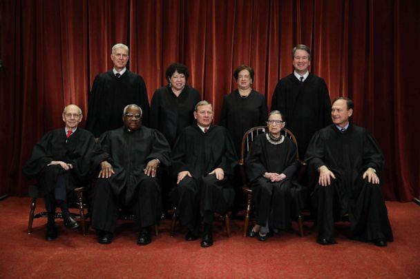 PHOTO: Associate Justice Ruth Bader Ginsburg sits with her colleagues on the United States Supreme Court during a group portrait after Associate Justice Brett Kavanaugh joined the court on Nov. 30, 2018, in Washington. (Chip Somodevilla/Getty Images, FILE)