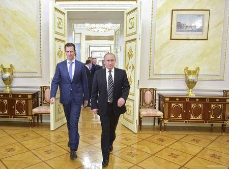 FILE PHOTO: Russian President Vladimir Putin (R) and Syrian President Bashar al-Assad enter a hall during a meeting at the Kremlin in Moscow, Russia, October 20, 2015. Alexei Druzhinin/RIA Novosti/Kremlin/via REUTERS