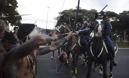 Police confront native Brazilians to impede them from marching towards the Mane Garrincha soccer stadium during a demonstration in Brasilia, May 27, 2014. REUTERS/Lunae Parracho