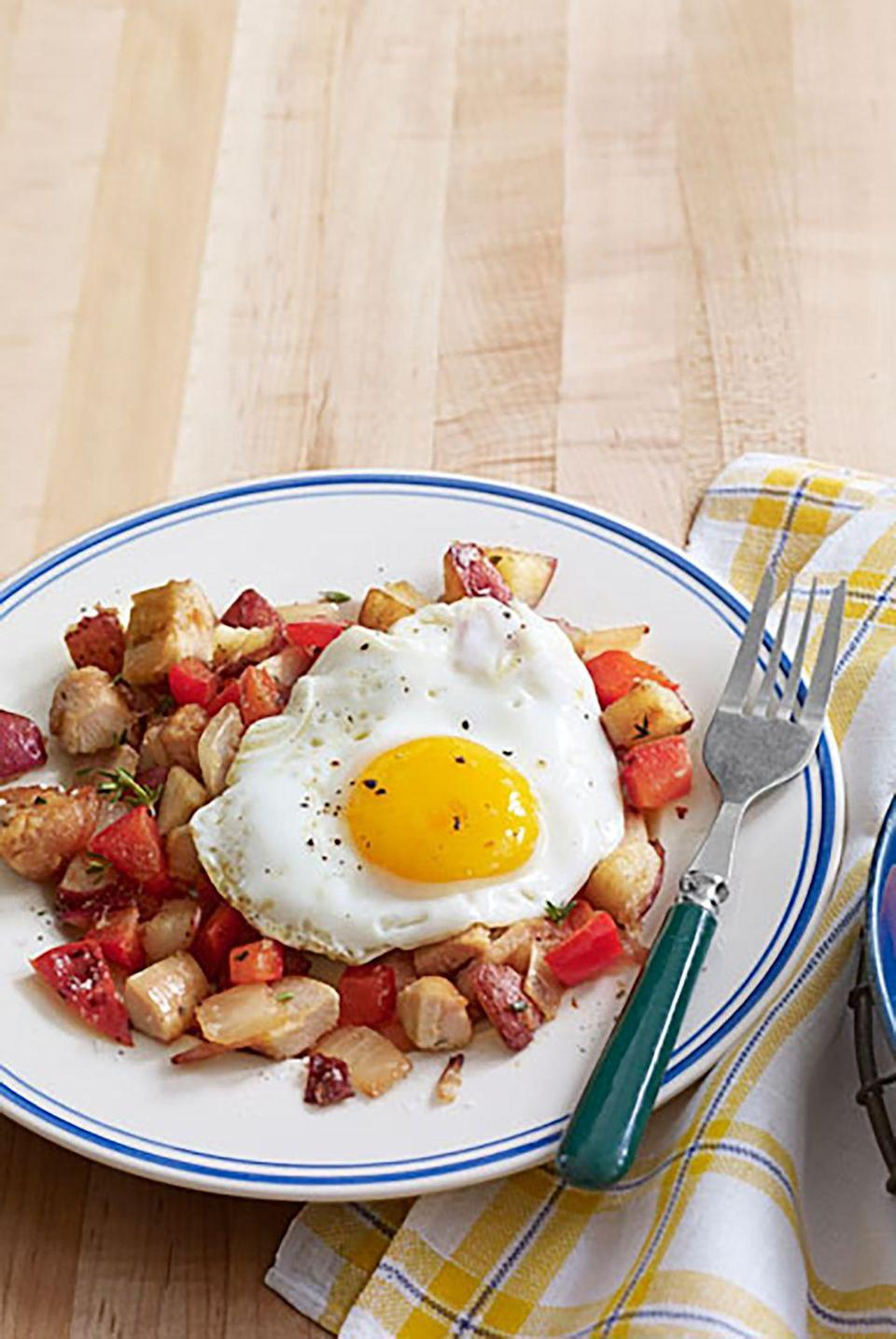 """<p>Replace corned beef with skinless turkey in this hash recipe to create a healthier alternative that your brunch guests will love.</p><p><strong><a href=""""https://www.countryliving.com/food-drinks/recipes/a3717/turkey-hash-sunny-side-up-eggs-recipe-clx1111/"""" rel=""""nofollow noopener"""" target=""""_blank"""" data-ylk=""""slk:Get the recipe"""" class=""""link rapid-noclick-resp"""">Get the recipe</a>.</strong></p>"""