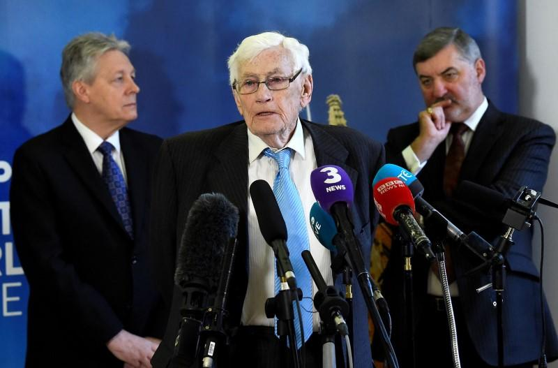FILE PHOTO: Seamus Mallon speaks as Peter Robinson and John Alderdice look on at an event to celebrate the 20th anniversary of the Good Friday Agreement, in Belfast
