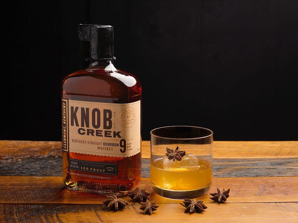 <p>Ingredients</p><p>2 oz Knob Creek Bourbon<br>1 bar spoon allspice dram<br>.25 oz rich demerara syrup*<br>1 dash Mole bitters<br>Zest of lemon<br>Zest of orange<br>Star anise (for garnish)</p><p><strong>Instructions</strong></p><p>Add all ingredients into a double rocks glass. Add a large cube of ice and stir lightly until drink is slightly chilled. Zest a lemon peel and an orange peel over top and discard both. Garnish with a star anise on top of the ice cube. </p><p>*Demerara sugar syrup: Add 10 oz of demerara sugar with 5 oz of water into a small saucepan. Bring to a boil or until sugar is completely dissolved. Remove from the stovetop and let cool. </p>