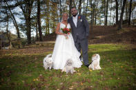 In this Oct. 27, 2017 photo, Kelly Curry and Patrick St. Onge pose with their dogs Charlie, left, Izzy and Zoey for a photo during their wedding day in Haddam, Conn. It's no longer unusual for brides and grooms to include pets in their wedding photos or even in the ceremony. But it can be tough to manage that along with everything else. (Jeffrey Herget/Studio 393 via AP)