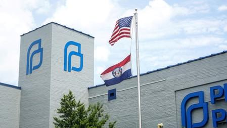 A Missouri State Flag  waves outside the Reproductive Health Services of Planned Parenthood in St. Louis