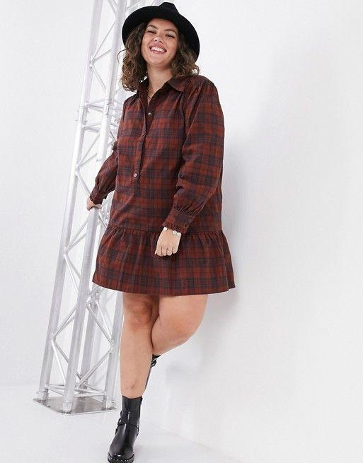 """<p><strong>Only Curve</strong></p><p>us.asos.com</p><p><strong>$60.00</strong></p><p><a href=""""https://go.redirectingat.com?id=74968X1596630&url=https%3A%2F%2Fwww.asos.com%2Fus%2Fonly-curve%2Fonly-curve-shirt-dress-in-check-print%2Fprd%2F20686036&sref=https%3A%2F%2Fwww.cosmopolitan.com%2Fstyle-beauty%2Ffashion%2Fg32678355%2Fflannel-outfits-how-to-wear%2F"""" rel=""""nofollow noopener"""" target=""""_blank"""" data-ylk=""""slk:Shop Now"""" class=""""link rapid-noclick-resp"""">Shop Now</a></p><p>If a plain ol' shirt dress is, well, too plain for you, consider one with a drop hem that adds a tiny extra ruffle. Throw on a black felt hat and patent leather boots with a red and burgundy one for the ultimate autumn vibes. </p>"""
