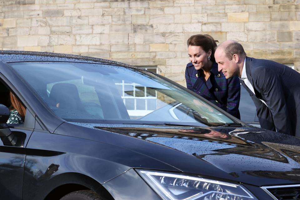 The Duke and Duchess of Cambridge greet NHS staff at a drive-in cinema (PA)
