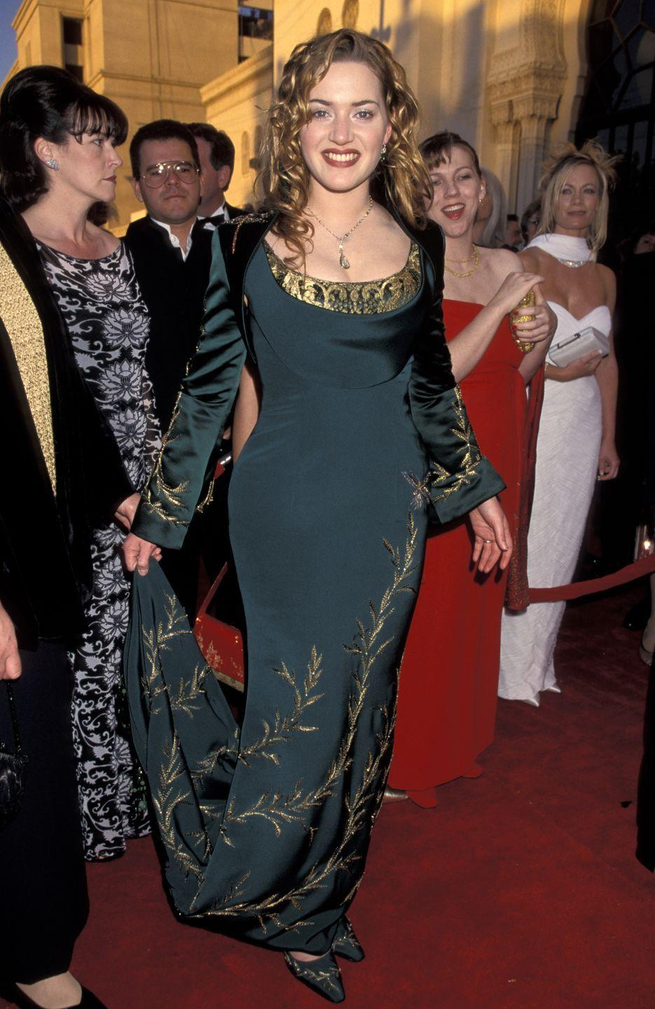 <p>At one glance, you might <em>think </em>Kate was on her way to the nearest Renaissance fair, but no, she was at the Academy Awards wearing this emerald-and-gold number. (This was also the year your fave movie <em>Titanic</em> took home the Oscar for Best Picture!) </p>