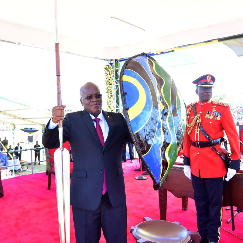 FILE PHOTO: FILE PHOTO: Tanzania's re-elected President John Pombe Magufuli holds a spear and shield from the elders after he was sworn-in for the second term at the Jamhuri stadium in Dodoma