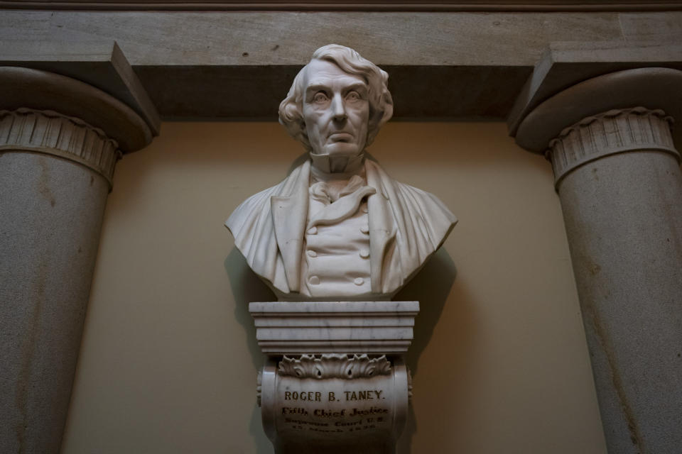 FILE - In this March 9, 2020, file photo a marble bust of Chief Justice Roger Taney is displayed in the Old Supreme Court Chamber in the U.S. Capitol in Washington. Taney, who came from a wealthy, slave-owning family in Calvert County, Md., led the Supreme Court in the 1857 ruling against Dred Scott, an enslaved African American man, who had sued for his freedom. The House is expected to approve a bill Tuesday that would remove from the bust of Taney from the Capitol, as well as statues of Jefferson Davis and others who served in the Confederacy. (AP Photo/J. Scott Applewhite, File)