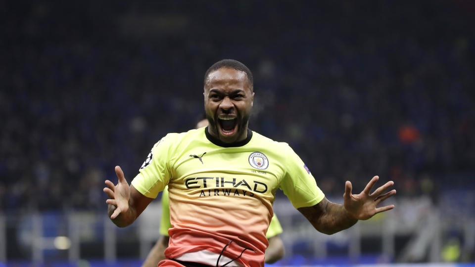 Manchester City's Raheem Sterling celebrates after scoring his side's opening goal during the Champions League group C soccer match between Atalanta and Manchester City at the San Siro stadium in Milan, Italy, Wednesday, Nov. 6, 2019. (AP Photo/Luca Bruno)