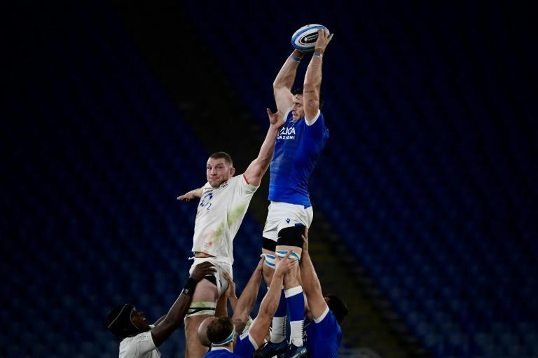 Italy flanker Abraham Steyn (R) catches the ball in a line out next to England flanker Sam Underhill during the Six Nations in Rome.