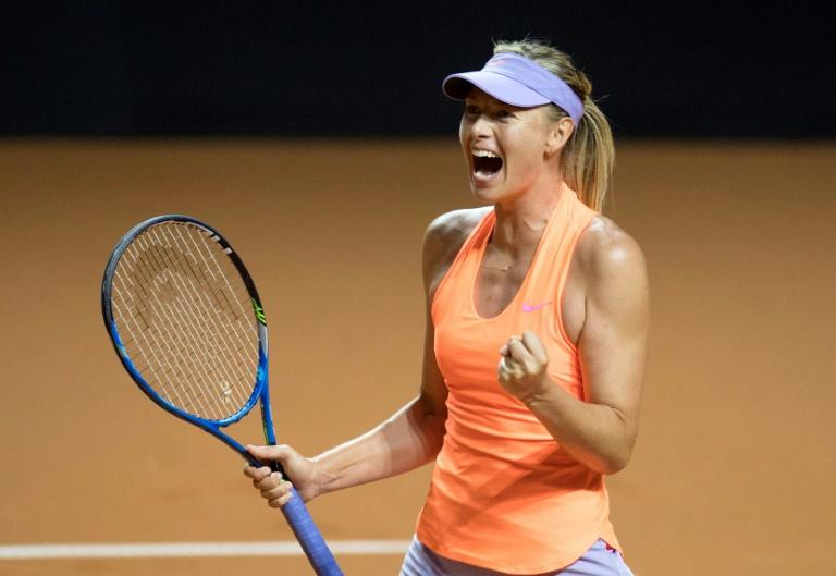 Russia's Maria Sharapova celebrates after defeating Russia's Ekaterina Makarova in their second round match at the WTA Porsche Tennis Grand Prix in Stuttgart, southwestern Germany, on April 27, 2017