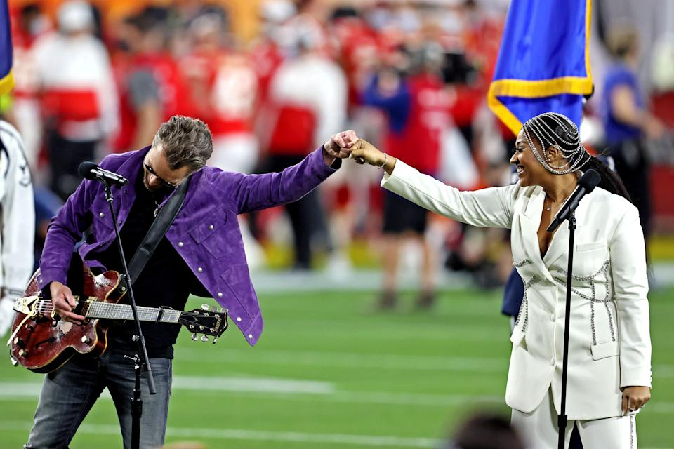 Jazmine Sullivan and Eric Church perform the national anthem before Super Bowl 55 between the Kansas City Chiefs and the Tampa Bay Buccaneers at Raymond James Stadium.