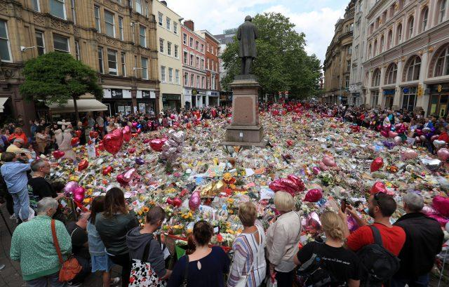 Flowers and tributes left in St Ann's Square in Manchester after the attack (PA)