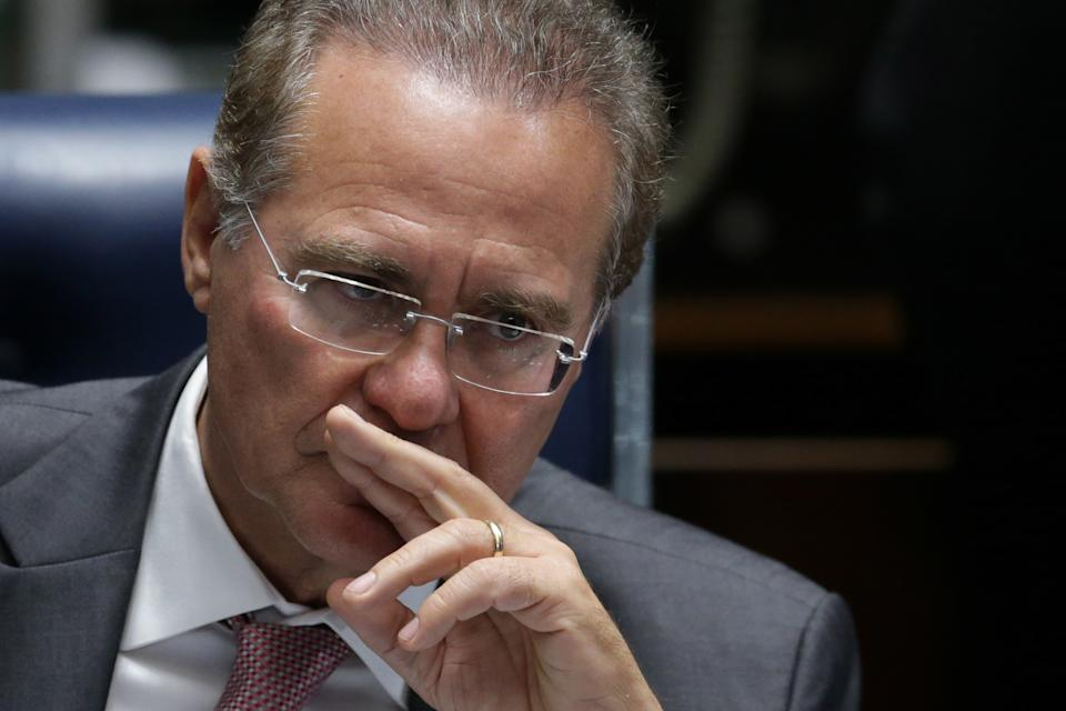 President of the Senate, Senator Renan Calheiros, listens in during the opening session for the election commission to analyze the impeachment process of Brazil's President Dilma Rousseff, at the Federal Senate, in Brasilia, Brazil, Monday, April 25, 2016. Brazil's Senate was determining the 21 members of a commission that will recommend whether or not to move forward with impeachment proceedings against embattled President Dilma Rousseff. (AP Photo/Eraldo Peres)