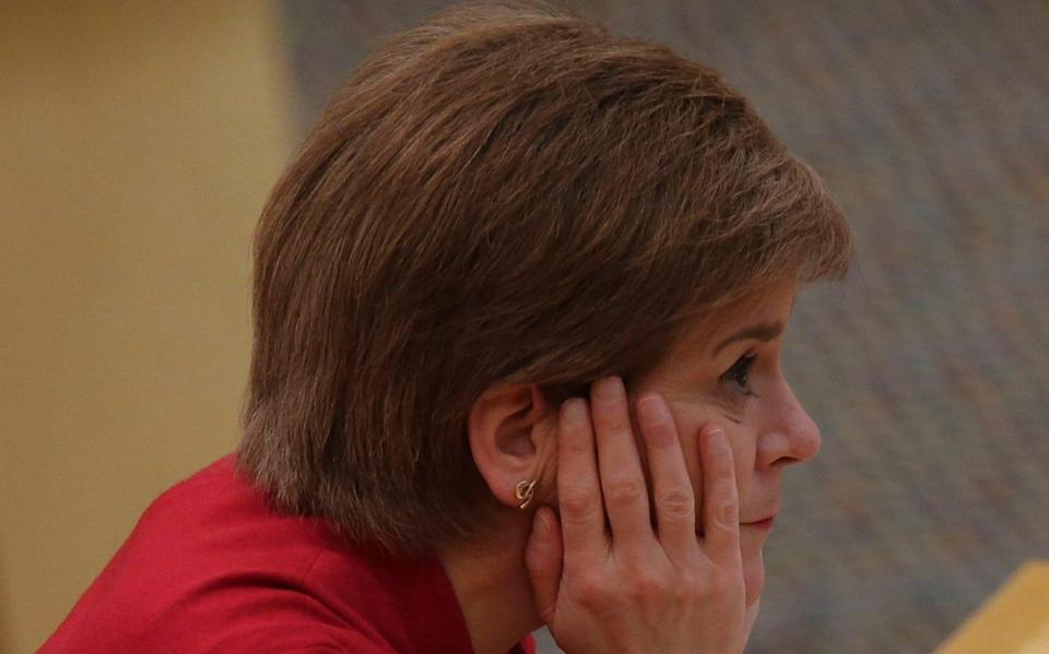"""EDINBURGH, SCOTLAND - FEBRUARY 23: Scottish First Minister Nicola Sturgeon reacts as she makes a statement on the coronavirus disease (COVID-19) restrictions at the Scottish Parliament on February 23, 2021 in Edinburgh, Scotland. The First Minister set out the country's plans for a gradual easing of the current lockdown restrictions, with the eventual return to the """"levels"""" system for different areas of Scotland.  - Bremner/Getty Images"""