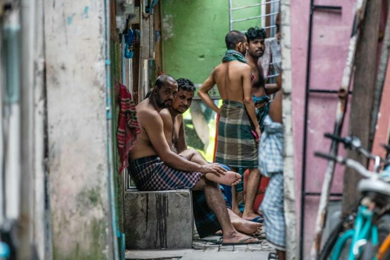 Workers from Bangladesh gather in an alleyway in Male, capital of the Maldives