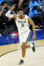 Baylor's MaCio Teague celebrates after scoring against Hartford during the first half of a college basketball game in the first round of the NCAA tournament at Lucas Oil Stadium in Indianapolis Friday, March 19, 2021, in Indianapolis, Tenn. (AP Photo/Mark Humphrey)