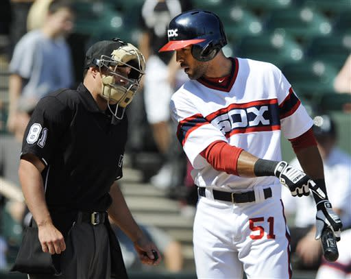 Chicago White Sox's Alex Rios argues with home plate umpire Quinn Wolcott left, after striking out during the ninth inning of a baseball game against the Cleveland Indians in Chicago, June 30, 2013. Cleveland won 4-0. (AP Photo/Paul Beaty)