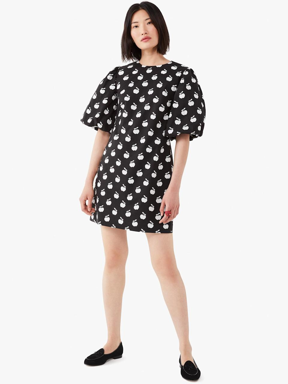 <p>This <span>Kate Spade New York Apple Toss Taxi Dress</span> ($268) makes us nostalgic for school. Style this design with opaque black tights.</p>