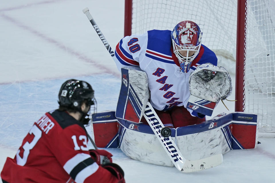 New York Rangers goaltender Alexandar Georgiev defends the goal during the second period of the NHL hockey game against the New Jersey Devils in Newark, N.J., Sunday, April 18, 2021. (AP Photo/Seth Wenig)