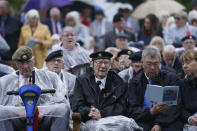 Veterans sing as they watch the official opening of the British Normandy Memorial in France via a live feed, during a ceremony at the National Memorial Arboretum in Alrewas, England, Sunday, June 6, 2021. Several ceremonies are scheduled on Sunday to commemorate the 77th anniversary of D-Day that led to the liberation of France and Europe from the German occupation. On June 6, 1944, more than 150,000 Allied troops landed on code-named beaches, carried by 7,000 boats. (Jacob King/PA via AP)