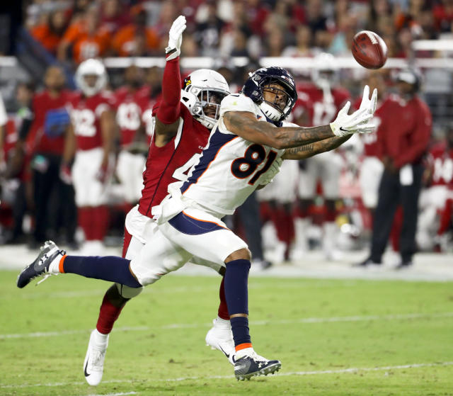 Denver Broncos wide receiver Tim Patrick can't hold on to a pass under pressure from Arizona Cardinals's Tim Scott during the first half of a preseason NFL football game Thursday, Aug. 30, 2018, in Glendale, Ariz. (AP Photo/Matt York)