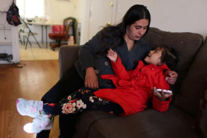 Emiliana, 32, sits with her daughter Emily, 5, at their apartment in Los Angeles