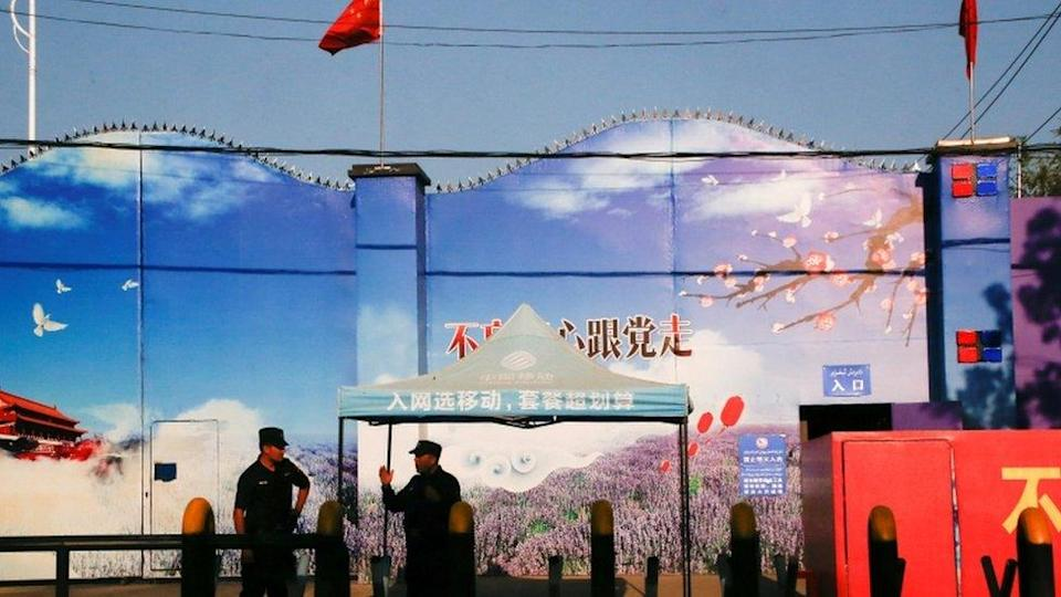Security guards stand at the gates of what is officially known as a vocational skills education centre in Huocheng County in Xinjiang Uighur Autonomous Region, China September 3, 2018