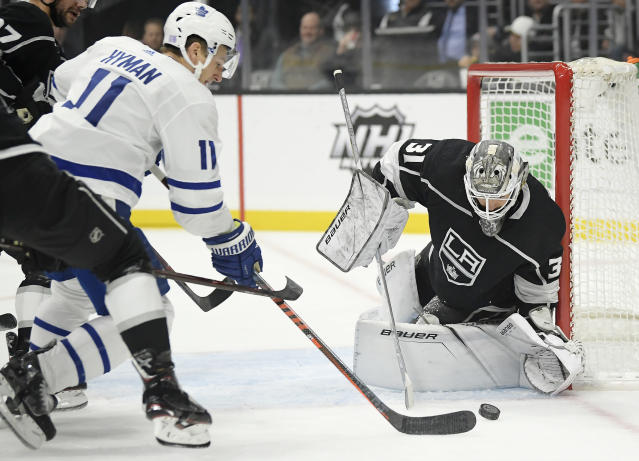 Toronto Maple Leafs left wing Zach Hyman, left, tries to get a shot past Los Angeles Kings goaltender Peter Budaj, of Slovakia, during the first period of an NHL game Tuesday, Nov. 13, 2018, in Los Angeles. (AP Photo/Mark J. Terrill)