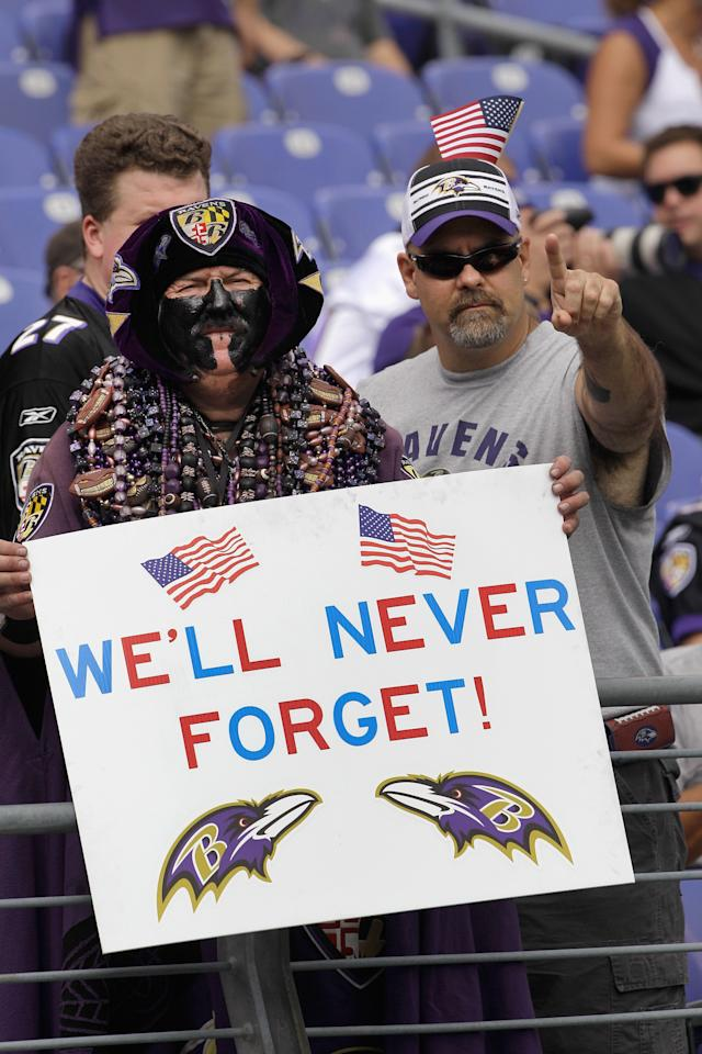 BALTIMORE, MD - SEPTEMBER 11: Baltimore Ravens fans poses with a sign commemorating the 10th anniversary of the September 11, 2001 terrorist attacks before the start of the season opener between Baltimore Ravens and Pittsburgh Steelers game at M&T Bank Stadium on September 11, 2011 in Baltimore, Maryland.  (Photo by Rob Carr/Getty Images)