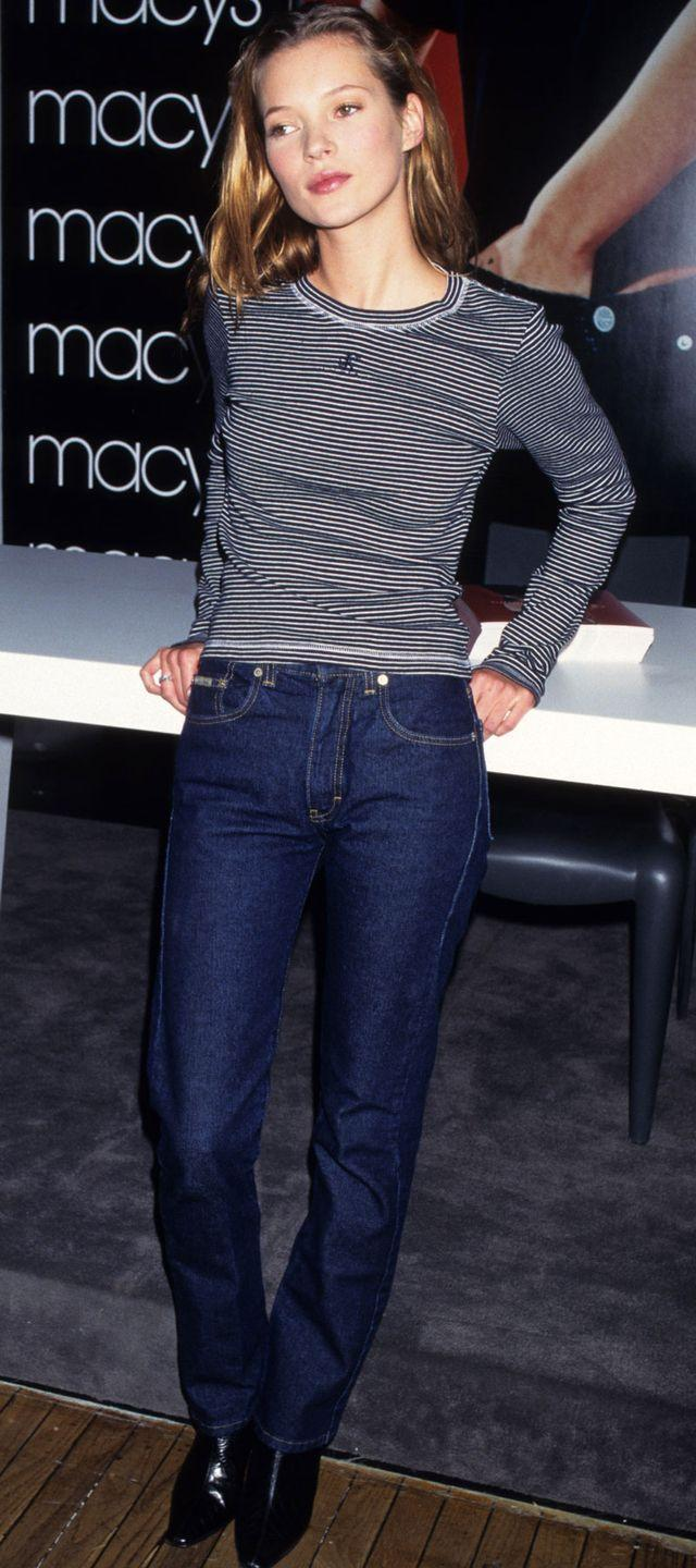 <p>Kate Moss promoting Calvin Klein jeans at an event. Jeans were starting to become a little more stretchy, less stiff material.</p>