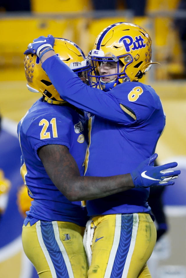 Pittsburgh quarterback Kenny Pickett (8) celebrates with running back A.J. Davis (21) after running for a touchdown against North Carolina during overtime of an NCAA football game Thursday, Nov. 14, 2019, in Pittsburgh. Pittsburgh won 34-27. (AP Photo/Keith Srakocic)