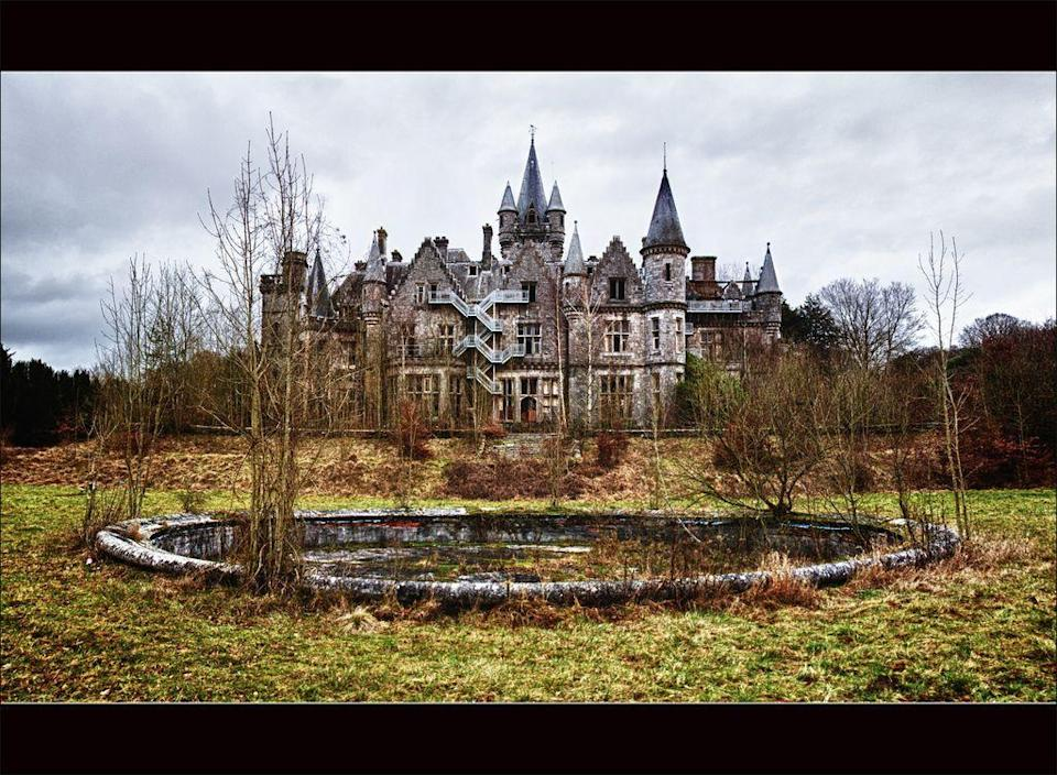 """<p>Also known as Château de Noisy, this mansion was built for the Liedekerke-Beaufort family in 1866, who relocated there following the French Revolution. It stayed in the family until World War II, when it was repossessed by Belgium's National Railway Company. It housed sick and orphaned children until 1980, after which it was abandoned. Although there were a number of offers to buy it, the previously ornate castle was <a href=""""http://www.byronhartshorn.com/2017/05/31/chateau-de-noisy-is-being-demolished-and-you-might-be-the-reason-why/"""" rel=""""nofollow noopener"""" target=""""_blank"""" data-ylk=""""slk:slated to be demolished last year"""" class=""""link rapid-noclick-resp"""">slated to be demolished last year</a>.</p>"""
