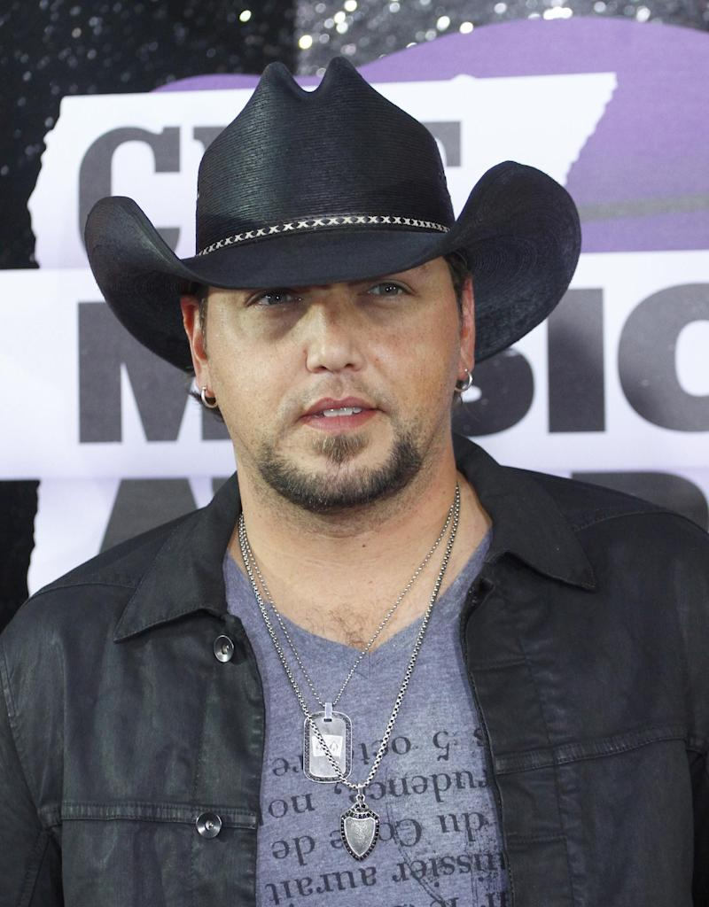 FILE - This June 5, 2013 file photo shows country singer Jason Aldean at the 2013 CMT Music Awards at Bridgestone Arena in Nashville, Tenn. Police in Indiana say a man was killed early Monday, Oct. 28, when he was struck by a tour bus belonging to country star Jason Aldean. (Photo by Wade Payne /Invision/AP, File)