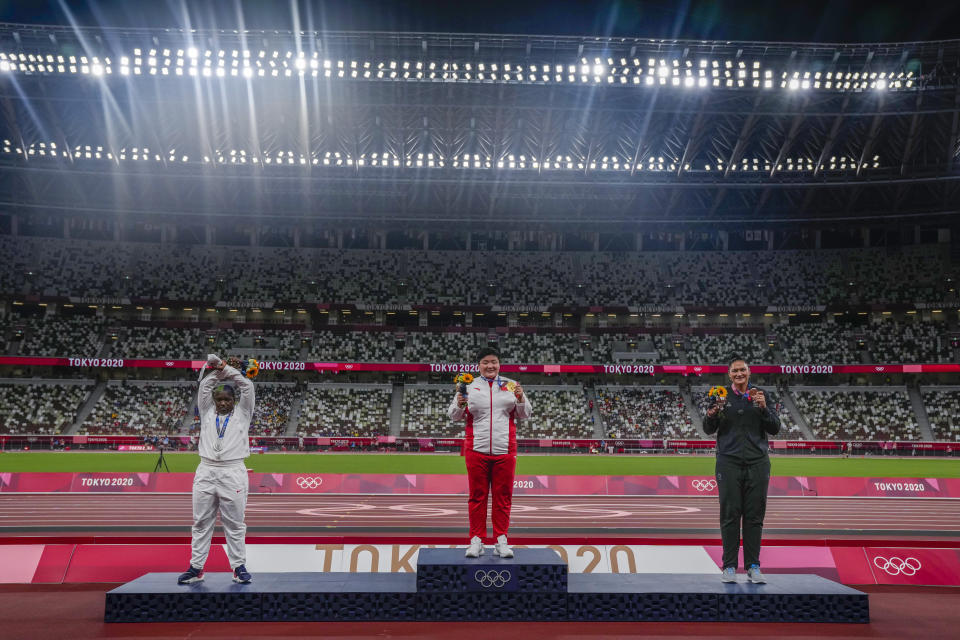 China's Lijia Gong, center, poses with her gold medal after winning women's shot put next to Raven Saunders, of the United States, left, silver medal, and New Zealand's Valerie Adams, bronze medal, at the 2020 Summer Olympics, Sunday, Aug. 1, 2021, in Tokyo, Japan. (AP Photo/Francisco Seco)