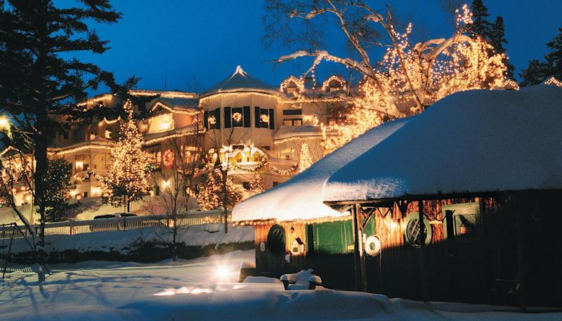 This 2011 photo provided by the Mirror Lake Inn, shows the inn decked out with holiday lights in Lake Placid, N.Y. The inn was founded in the 1920s as Mir-a-Lac, was renamed Mirror Lake Inn in 1933 and has been owned by Ed and Lisa Weibrecht since 1976. (AP Photo/Mirror Lake Inn/Shaun Ondak)
