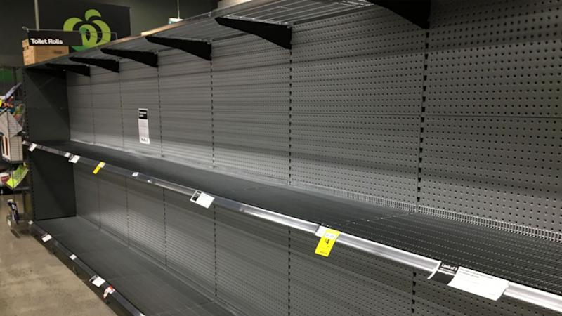 Empty supermarket shelves in a Victorian Woolworths