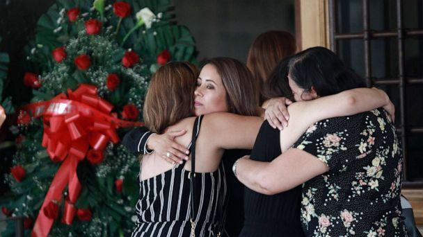 PHOTO: Tearful mourners hug outside a funeral home as they arrive to attend a wake for Elsa Mendoza, who was killed in the El Paso mass shooting, in Juarez, Mexico, Aug. 7, 2019. (Christian Chavez/AP Photo)