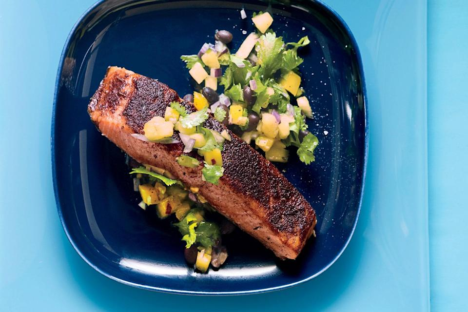 "Bright yellow mango, tossed with pineapple, black beans, and cilantro, adds a refreshingly sweet bite to this spice-loaded salmon. <a href=""https://www.epicurious.com/recipes/food/views/jamaican-jerk-salmon-and-mango-pineapple-salsa-364549?mbid=synd_yahoo_rss"" rel=""nofollow noopener"" target=""_blank"" data-ylk=""slk:See recipe."" class=""link rapid-noclick-resp"">See recipe.</a>"