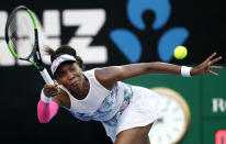 United States' Venus Williams makes a forehand return to Romania's Simona Halep during their third round match at the Australian Open tennis championships in Melbourne, Australia, Saturday, Jan. 19, 2019. (AP Photo/Kin Cheung)