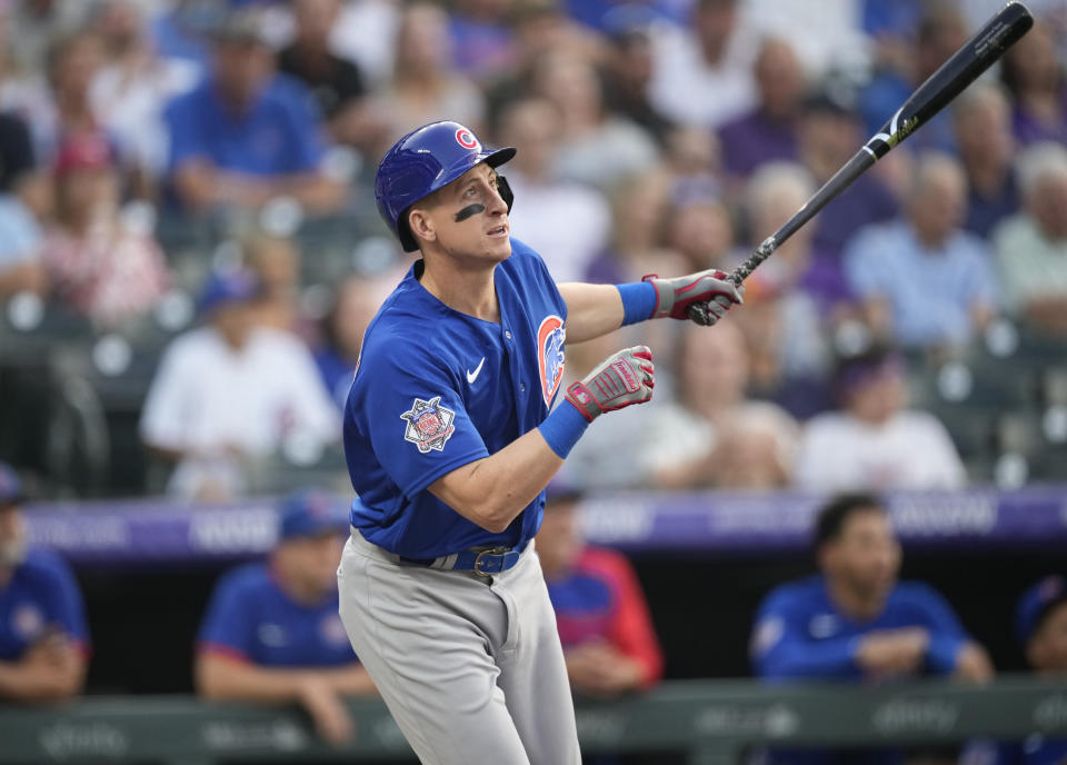 Chicago Cubs' Frank Schwindel flies out against Colorado Rockies starting pitcher Jon Gray in the second inning of a baseball game Wednesday, Aug. 4, 2021, in Denver. (AP Photo/David Zalubowski)