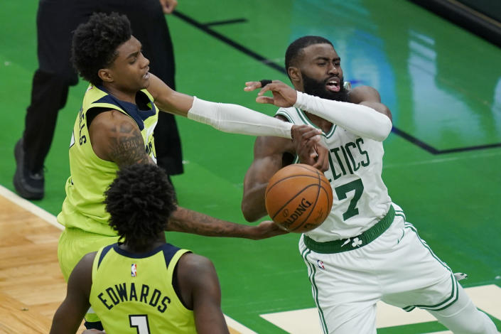 Boston Celtics guard Jaylen Brown (7) is fouled by Minnesota Timberwolves forward Jaden McDaniels, left, in the overtime period of an NBA basketball game, Friday, April 9, 2021, in Boston. (AP Photo/Elise Amendola)