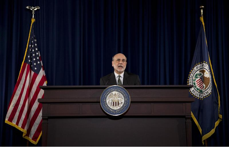 FILE-In this Thursday, Sept. 13, 2012, file photo, federal Reserve Chairman Ben Bernanke speaks during a news conference in Washington. Federal Reserve wants to find a clearer way to signal to the public when it might start raising interest rates. The Fed has told investors that it plans to keep short-term rates low for at least another three years. But it appears to be leaning toward setting a more specific target, according to minutes from the Fed's last policy meeting.  (AP Photo/Manuel Balce Ceneta. File)