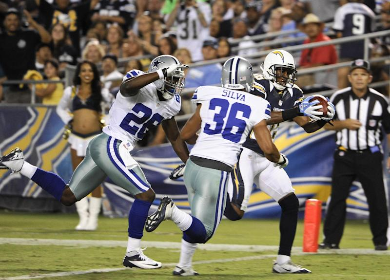 San Diego Chargers wide receiver Vincent Brown pulls in a touchdown pass as Dallas Cowboys defensive backs Mana Silva and Akwasi Owusu-Ansah arrive late during the second half of a NFL preseason football game Saturday, Aug. 18, 2012 in San Diego. (AP Photo/Denis Poroy)