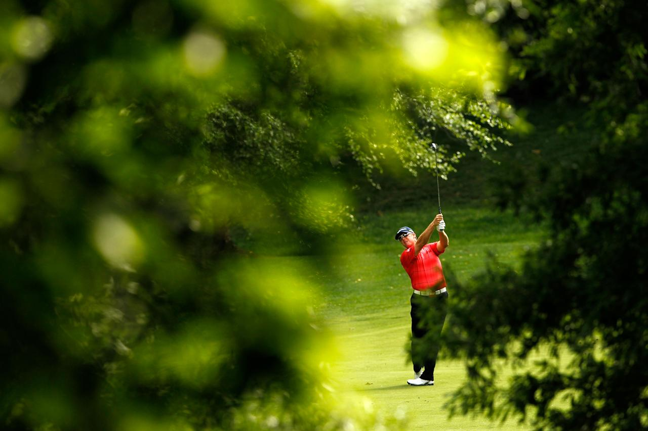 CHARLOTTE, NC - MAY 06:  D.A. Points of the United States hits an approach shot on the 12th hole during the final round of the Wells Fargo Championship at the Quail Hollow Club on May 6, 2012 in Charlotte, North Carolina.  (Photo by Streeter Lecka/Getty Images)