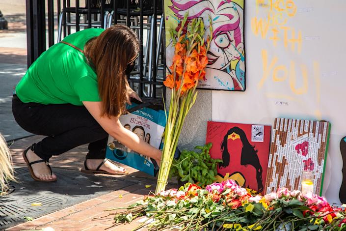 """As if in mourning, comics fans like Mariel Delmar have been leaving Comic-Con memorabilia at an unofficial memorial across from the San Diego Convention Center. <span class=""""copyright"""">(Jarrod Valliere / The San Diego Union-Tribune)</span>"""